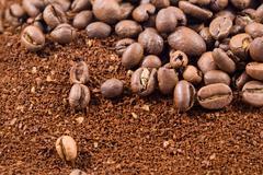 Coffee beans with coffee powder Stock Photos
