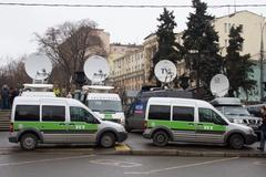 Buses broadcaster Russia Today near March of the opposition - stock photo