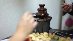 Chocolate fountain with pouring choco and fruits plate, close-up - stock footage