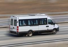 motor van goes on the  highway - stock photo