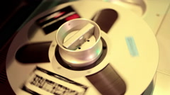 Tape reels spinning on 24-track audio deck Stock Footage