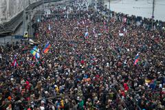 Column of oppositionists on mourning march of memory of Boris Nemtsov - stock photo