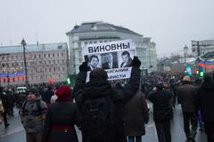 Moscow, Russia - March 1, 2015. The oppositionist bears the poster in which a Kuvituskuvat