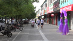 Typical sidewalk scene, Jiayuguan Stock Footage