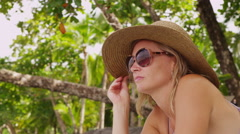 Woman laying on tropical beach Stock Footage