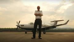 Proud Corporate Pilot Portrait with Jet Airplane Wide Stock Footage