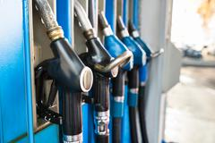 Close-up Of Fuel Pump Nozzles At The Gas Station - stock photo