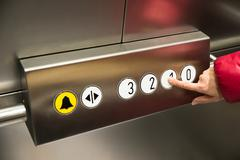 Close-up Of A Person In Elevator Pressing The First Floor Button Kuvituskuvat