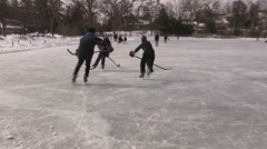 Canadian pond and ice hockey on cold winter day Stock Footage