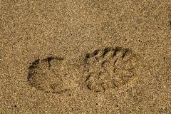 Single right shoe print in sand - stock photo