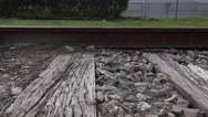 Stock Video Footage of Close Up Old Iron Railroad Tracks Tracking Shot