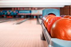 Closeup of bowling balls lying on bowling alley Stock Photos