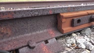 Stock Video Footage of Close Up Tracking Shot Of Railroad Track Joint 02