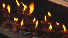 Burning oil lamps at the Swayambhunath stupa at Kathmandu in Nepal - stock footage