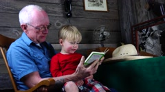 Grandpa and grandson reading, family life Stock Footage