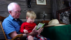Grandpa and grandson reading, generations Stock Footage
