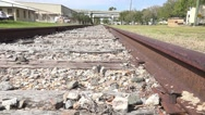 Stock Video Footage of Low Angle Close Up Railroad Thru Industrial District