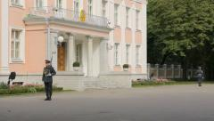 Presidential Palace of Estonia with two guards, editorial Stock Footage
