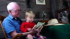 Grandpa and grandson reading, early learning Stock Footage