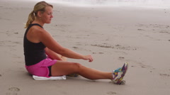Woman stretching and preparing for run - stock footage