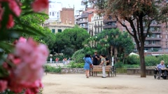Spain Catalonia Barcelona Antoni Gaudi Sagrada Familia Cathedral and Pink Flower Stock Footage
