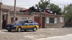 Taxi and piled plastic crates in poor neighborhood, Jiayuguan - stock footage