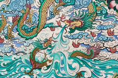 THAILAND - NOV 16: Abstract of dragon colorful painted on wall in temple on N Stock Photos