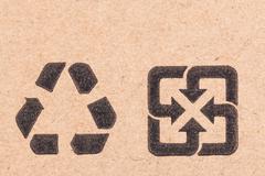 Recycling green dot symbol fragile on cardboard box Stock Photos