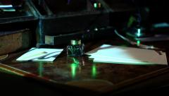 Projected writing calligraphy on old desk jib up 3 - stock footage