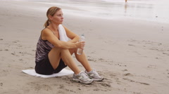 Woman drinking water after run - stock footage