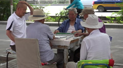 Men playing Mahjong on sidewalk tight shot, Jiayuguan Stock Footage