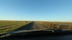 Driving and stopping on farm road with hay bales. Saskatchewan, Canada Stock Footage