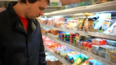 Man buys dairy products at the supermarket. HD. 1920x1080 Stock Footage