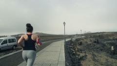 Woman jogging through boardwalk HD Stock Footage