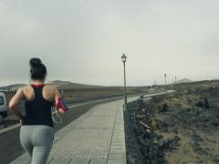 Woman jogging through boardwalk NTSC Stock Footage
