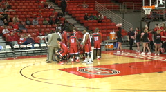 4K college basketball team breaking from tight huddle - stock footage