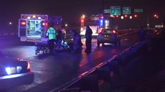 Emergency Scene With Medics Responding To A Pedestrian Hit By A Car At Night Stock Footage