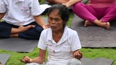 Video 1920x1080 Balinese old woman practice yoga in Ubud, Indonesia Stock Footage