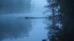Stock Video Footage of Eerie Lake covered in Fog