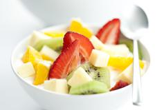 Fruit salad with chunks of fruit and yogurt Stock Photos