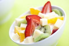 fruit salad with chunks of fruit and yogurt - stock photo