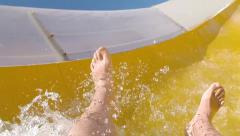 Enjoyment on the water slide, slow motion - stock footage