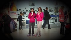 Two teen age girls in sportswear drinking cola - stock footage