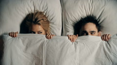 Hiding Under Sheets Stock Footage
