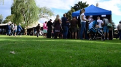 People Gather Around a Tent to Buy Tokens for the Clarens Craft Beer Festival Stock Footage