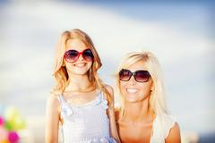 mother and child in sunglasses - stock photo