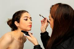 make up artist and model - stock photo