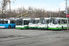 trolleybuses row - stock photo