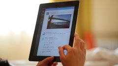 reading social media on iPad - stock footage