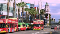 4K, UHD, Tourist buses on Hollywood boulevard in Los Angeles, California Stock Footage